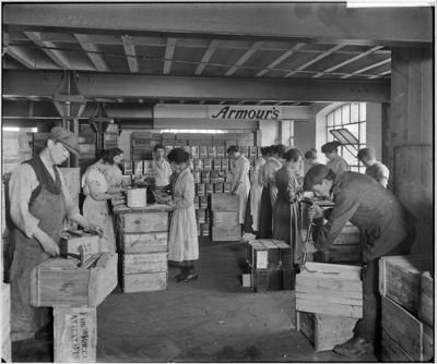 Tooley Street 1919, Armour and Company, men and women at work packing and labelling crates in the warehouse.  X.png
