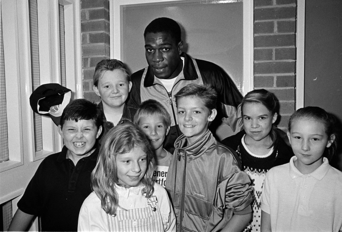 Southwark Park Athletics 1989.Frank Bruno poses with some young athletes at Southwark Park.  X.png