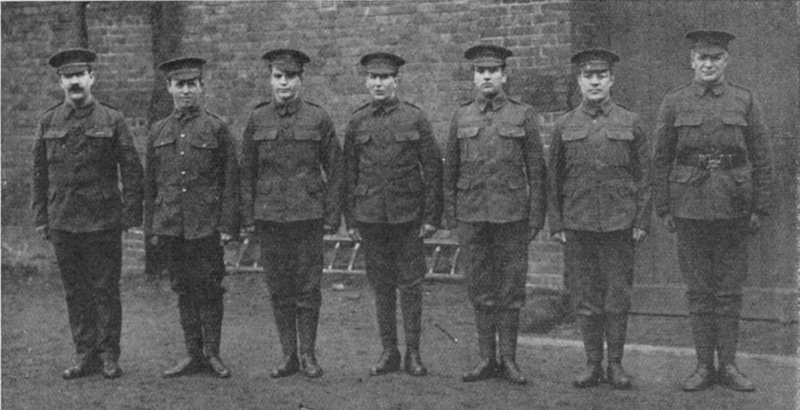 Jack Goldswain 1915, Bermondsey born boxer, 1st Surrey Rifles. Sergeant Taylor, Dick Burge, Dai Roberts, Duke Lynch, W.W. Turner, Jack Goldswain and L-CPL Pat O'Keeffe, 26 May 1915, all boxers.  X.png