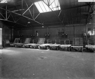Surrey Commercial Docks, Rotherhithe c1920. Electric motorised goods trolleys charging in the electric garage.   X.png