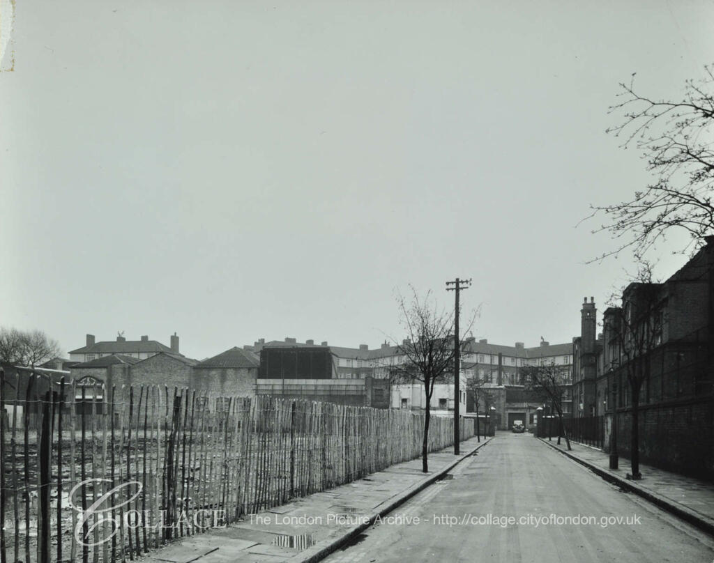 Clack Street, Rotherhithe, looking south towards Albion Street. On left is vacant site formerly occupied by a school. c1952.  X.png