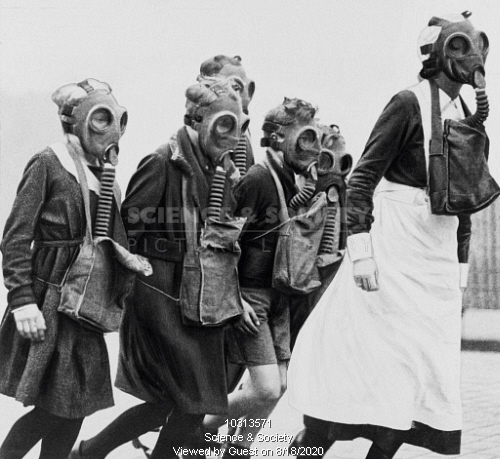 Schoolchildren wearing gas masks, 1 November 1934.  X.png