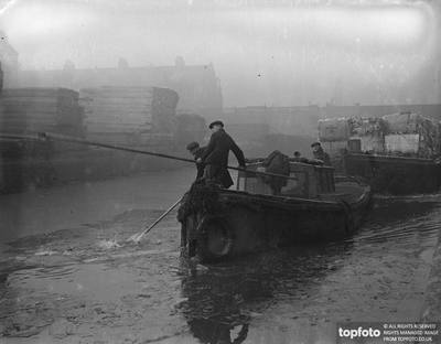 Surrey Canal at Camberwell c1936, barge men breaking the thick ice, where it has been frozen over by the severe weather.  X.png