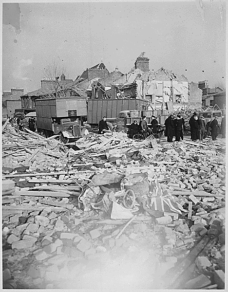 A British Flag lies among the rubble of homes smashed by the Camberwell Road Rocket explosion. V-bomb damage, c1944.  X.png
