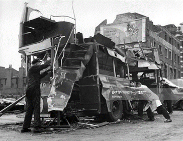 Bomb damage near Waterloo Station. A Blitzed bus caused by blast from a V1 flying bomb. June 1944.   X.png