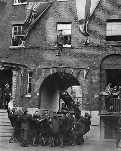 Southwark Bridge Road 1922.  A fireman jumping from a window into a safety blanket.  X.png