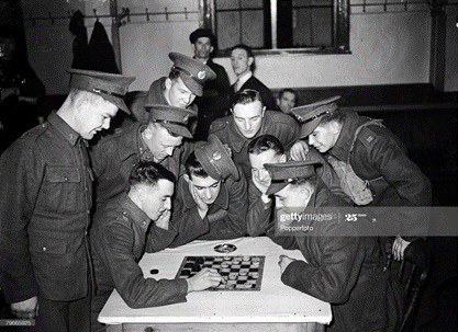 Waterloo Road World War II, London, Young soldiers playing draughts at the Waterloo station canteen provided by the YMCA.   X.png