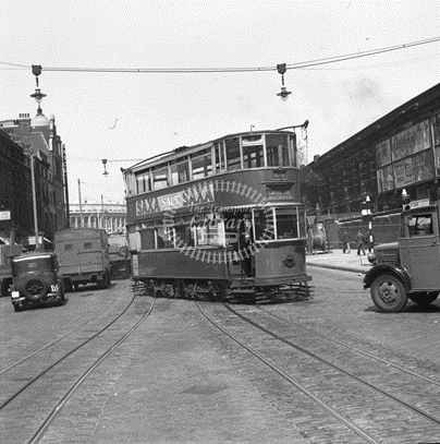 Blackfriars Road c1950, a No. 26 Tram coming out of Southwark Street (right).   X.png