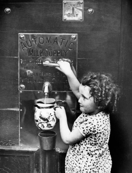 Milk vending machine in London, England, circa 1931..jpg