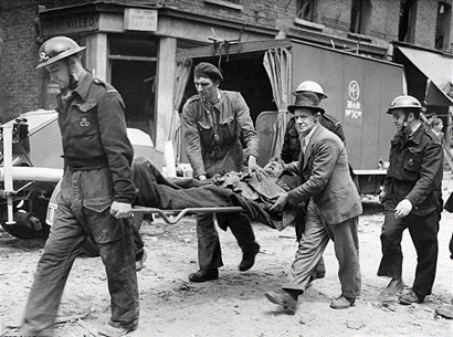 East Lane, Robot plane damage WW2. A casualty being taken to ambulance with a friend comforting him after he had helped to get him out. June 1944.  X.png