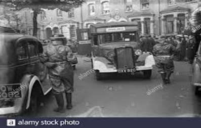 Old Kent Road. Air Raid Precaution exercise, a Bedford ambulance taking part in the drill c1939.  X.png