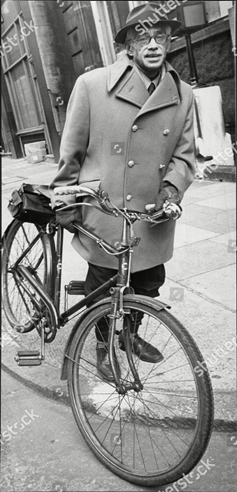 Dr Walter Rahman seen at Tower Bridge Court with his bicycle, 1971.  X.png