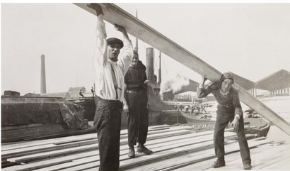 Surrey Docks c1930, men moving timber.  1  X.png